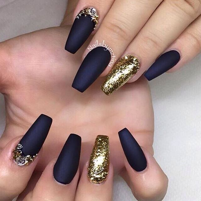 Matte black nails with gold