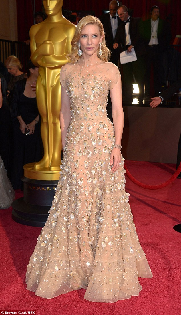 Exquisite:She wowed on the Oscars red carpet last year in an epic couture Armani gold gown and jewels - which cost a combined $18.1 million