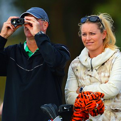 Tiger Woods' caddie Joe LaCava stands with skier Lindsey Vonn as they ...