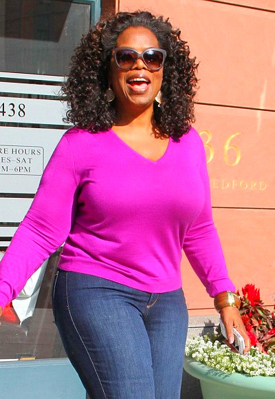 Oprah Winfrey shows off new slimmer figure in fuchsia jumper and ...