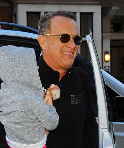 Tom Hanks pictured arriving at Claridges Hotel carrying his grandchild ...