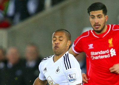 Swansea midfielder Wayne Routledge evades a challenge from Liverpool ...