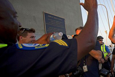Groups started at either end of Charleston's main bridge then met in ...