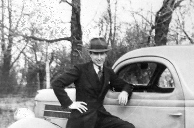 Vern as a missionary, with his first car.
