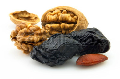 Dried prunes with walnuts | Stock Photo | Colourbox