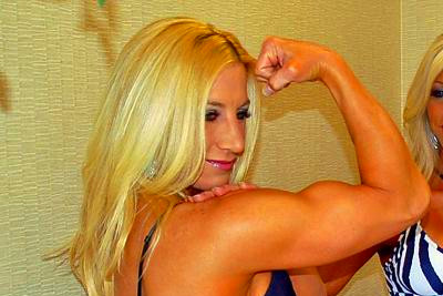 Figure BFFs: Courtney poses her peaked bicep for the camera while ...