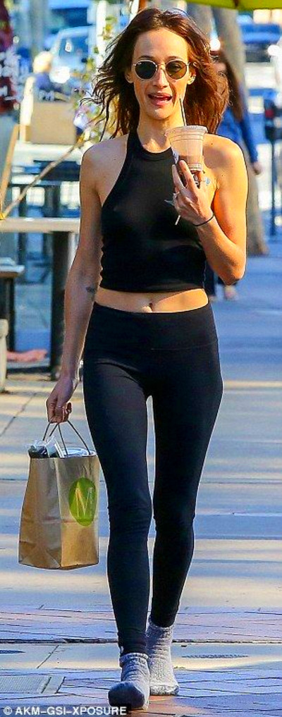 Teeny tiny: Maggie showed off her flat stomach in a black '90s style ...