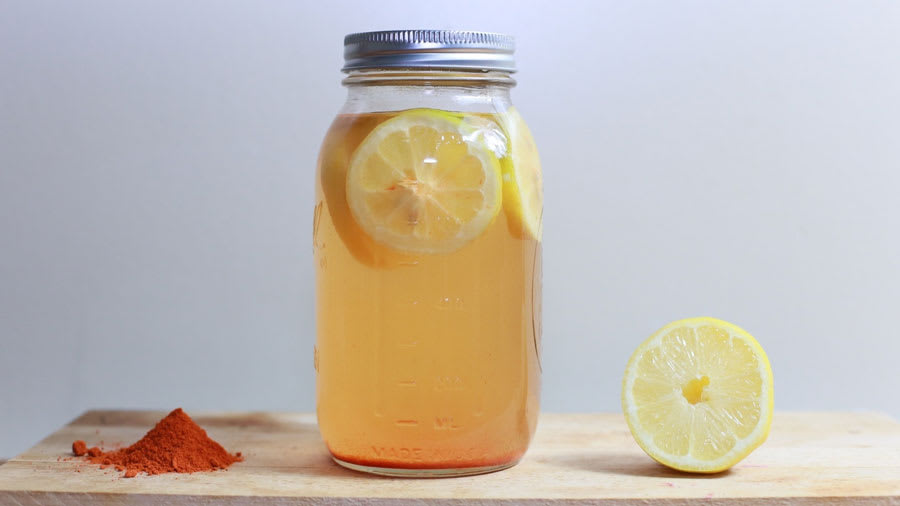 Lemon water and cayenne pepper based detox water in a glass