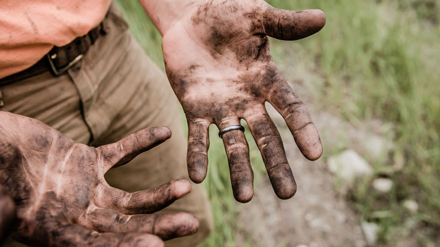 closeup of hands covered in dirt