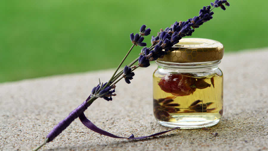 ​rose-oil-flower-petals-in-small-jar-with-lavender-flowers