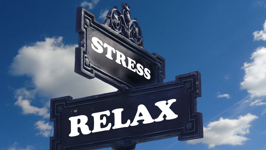 Crossroad sign with words stress and relax