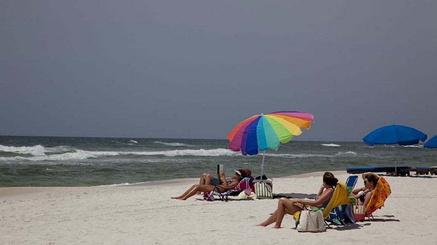 People on the beach with color umbrella