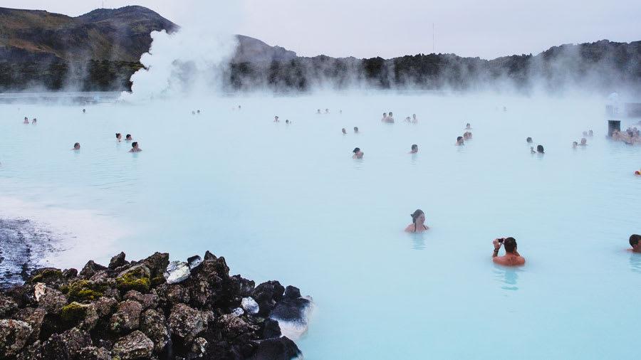 people bathing in hot springs