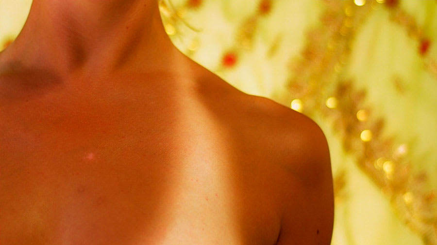 Tan lines on the chest of a woman