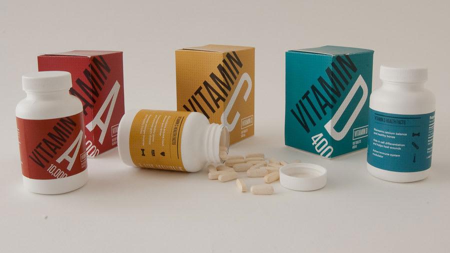 Vitamin A, Vitamin C, and Vitamin D pills, bottles, and boxes
