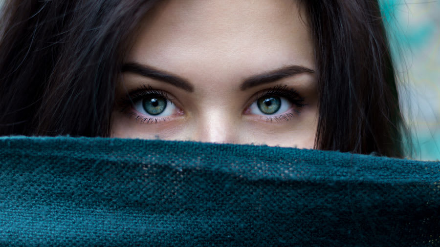 Dark haired woman with green eyes