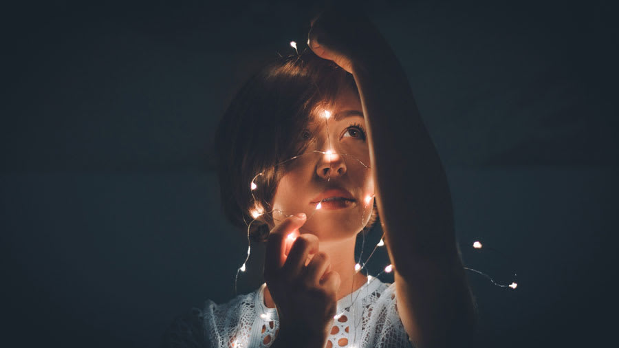Woman with LED lights around her youthful face