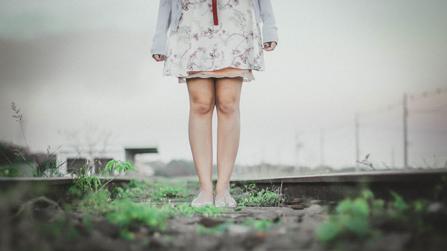 Woman in a field without cellulite on her legs