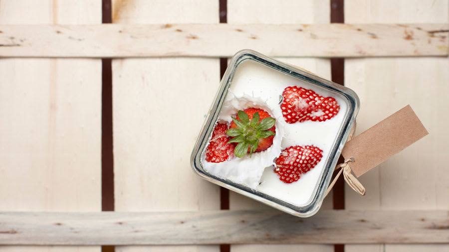 Kefir with strawberries in square jar
