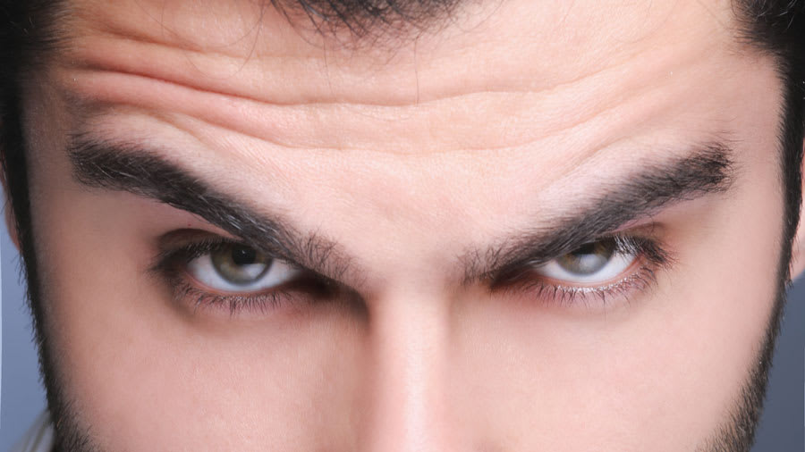Man with well-manicured brown eyebrows