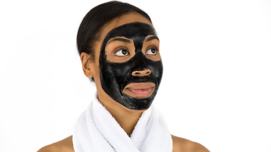 Woman with activated charcoal face mask