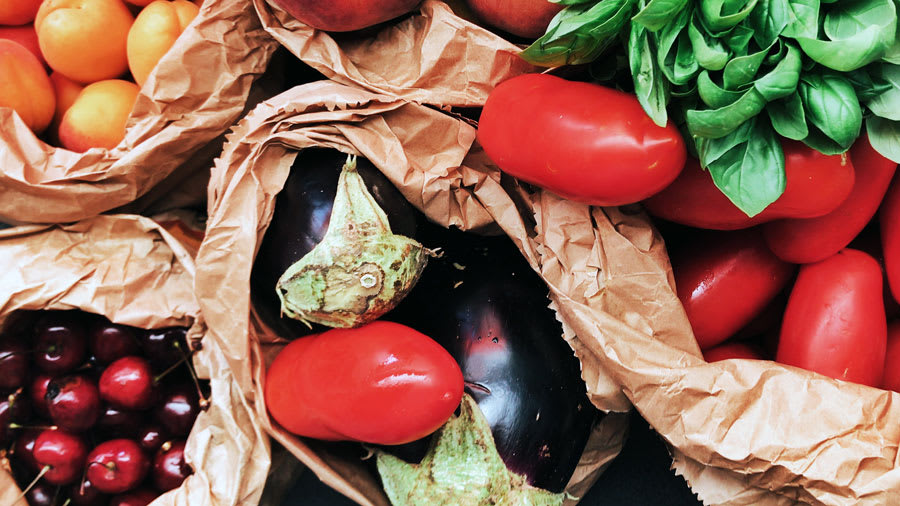 Fruits and vegetables with tomatoes eggplants cherries peaches spinach