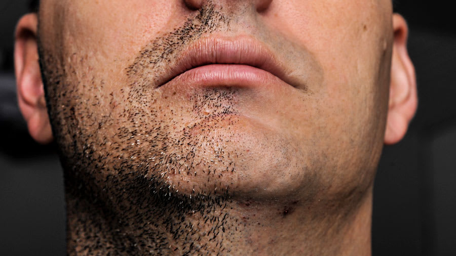 Half shaven beard on the man's face