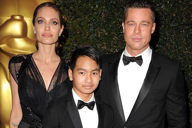 Анджелина Джоли и Брэд Питт с сыном