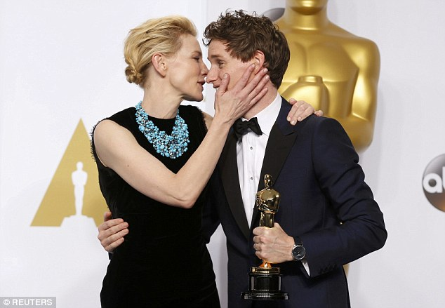 Sweet: The pair shared a hug on stage before Cate handed over the gong