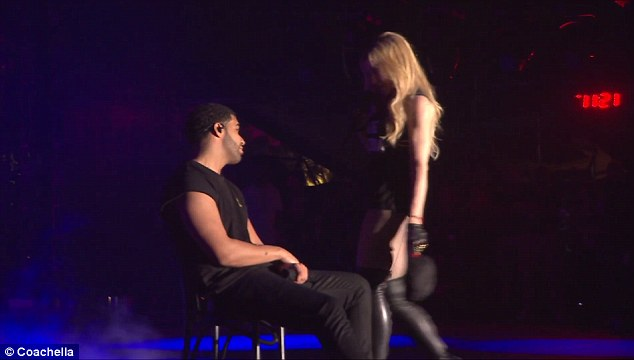 Did he know it was coming? Drake waited patiently as the beauty circled him while singing Express Yourself