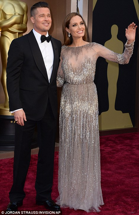 Magic twosome: Brad Pitt, a nominated producer for 12 Years A Slave arrived with Angelina