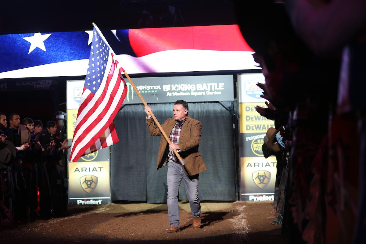 Rich Miller presents the American Flag in the opening of the second round during the 25th PBR: Unleash The Beast Monster Energy Buck Off at The Garden in New York City. Photo by Andy Watson