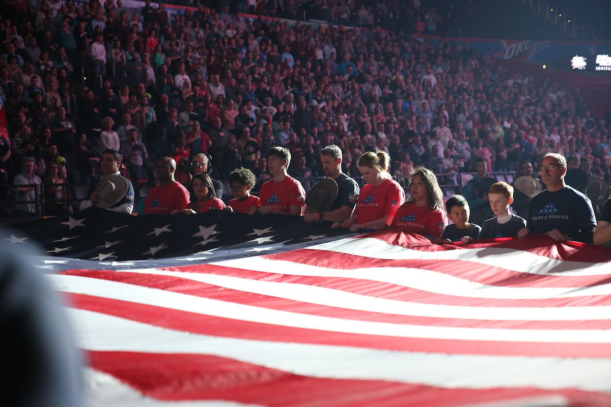 Members from the OKC Folds of Honor present the American Flag during the first round of the 25th PBR: Unleash The Beast in Oklahoma City. Photo by Andy Watson