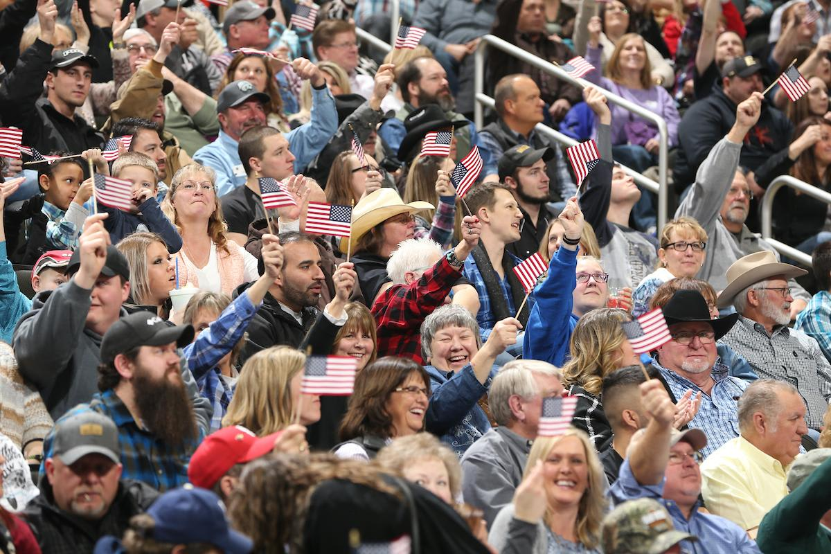 The crowd waves their flags during round 1 of The 25th PBR: Unleash The Beast, Caterpillar Classic in Kansas City. Photo by Andy Watson