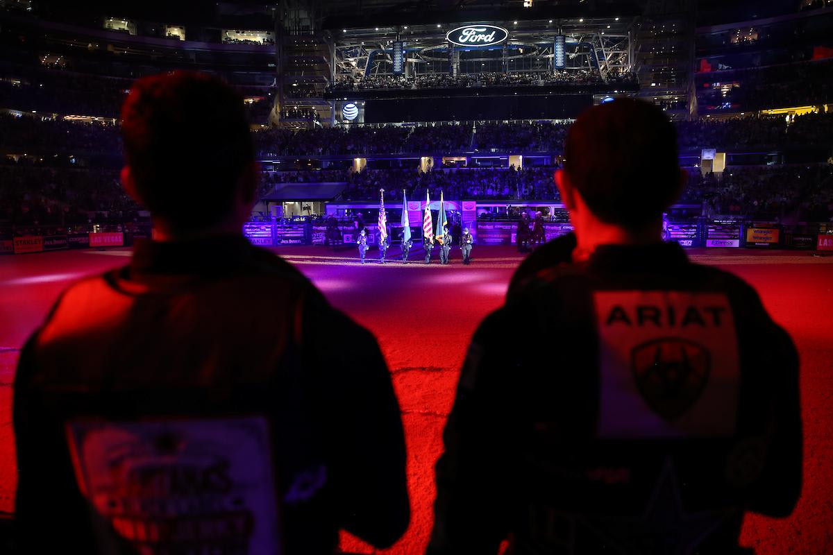 Border Patrol presents the American Flag during the opening of the first round in Arlington. Photo by Andy Watson