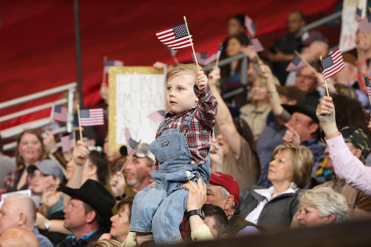 A young fan waves his flag during the second round in North Little Rock. Photo by Andy Watson