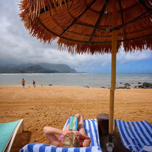 Lounging on beach at St Regis Princeville, Kauai