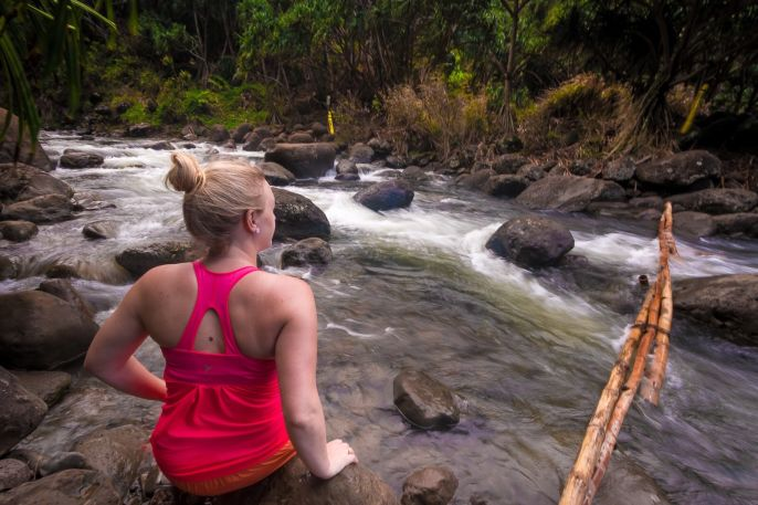 Crossing a river of the Kalalau Trail