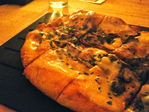 For what looked like a promising truffle cheese and wild mushroom pizza, I was not wild about it.