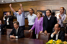 Prime Minister David Cameron of the United Kingdom, President Barack Obama, Chancellor Angela Merkel of Germany, Jose Manuel Barroso, President of the European Commission, President Francois Hollande of France and others react emotionally while watching the overtime shootout of the Chelsea vs. Bayern Munich Champions League final, in the Laurel Cabin conference room during the G8 Summit at Camp David, Maryland, May 19, 2012. Cameron raises his arms triumphantly as the Chelsea team wins their first Champions League title in the overtime shootout.