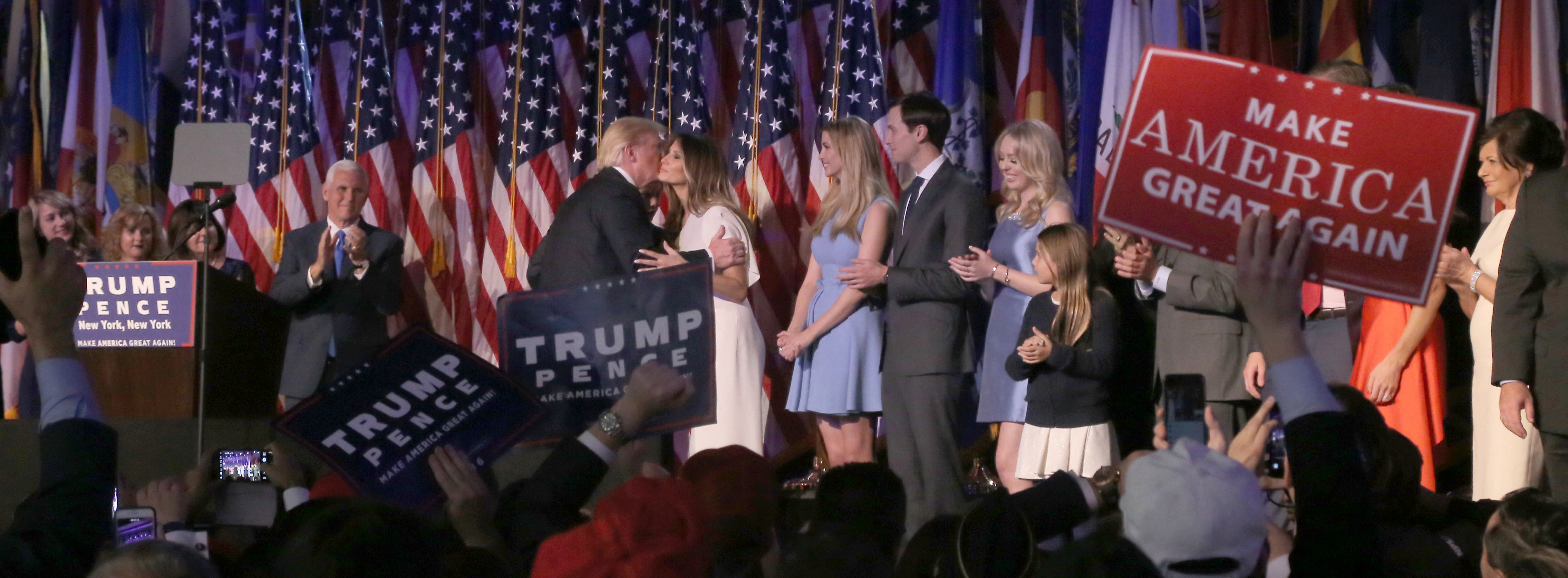 Donald Trump kisses his wife and future First Lady, Melania, but many feel Ivanka will be her father's real influence