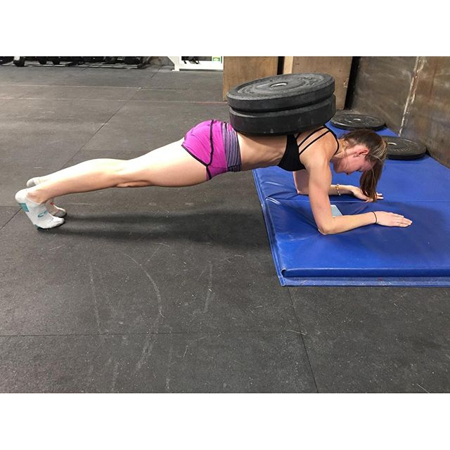 Usually were not a fan of weighted planks but there are some clear benefits. It can teach proper bracing as it relates to weightlifting and gymnastics movements. Ensure hips are neutral and midline is braced in the same positions you would like to see reinforced. Keep the time under tension similar to the amount of time you would expect you be in the position you are trying to improve. Remember this is an assistance exercise so there must be a clear intention of the WHY behind this exercise.