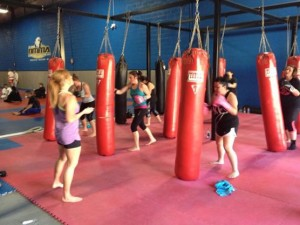 students in fitness kickboxing at Nashville MMA