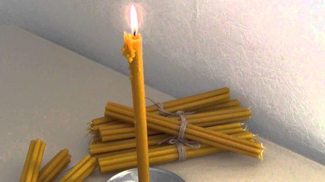 Очищение дома свечой