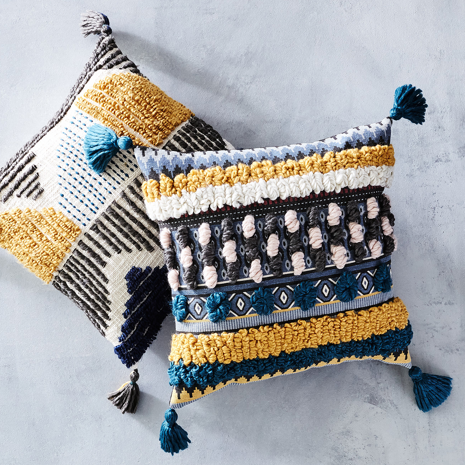 Embroidered Circle Pillow with Tassels
