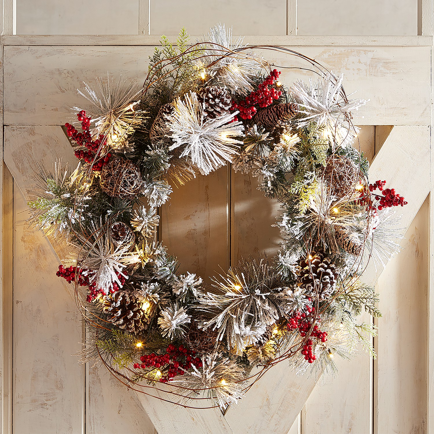 "variation thumbnail of 24"" LED Pre-Lit Snow Dusted Faux Pine Wreath"