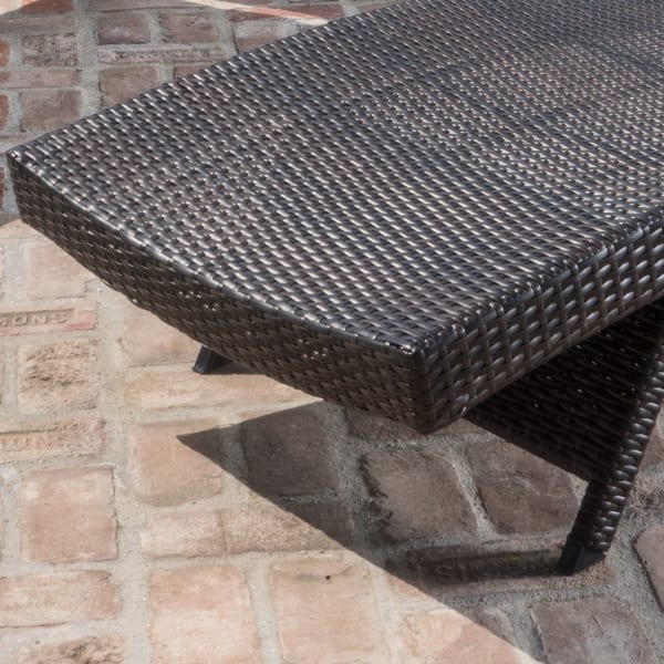 Brown Outdoor Chaise Lounge with Orange Cushion