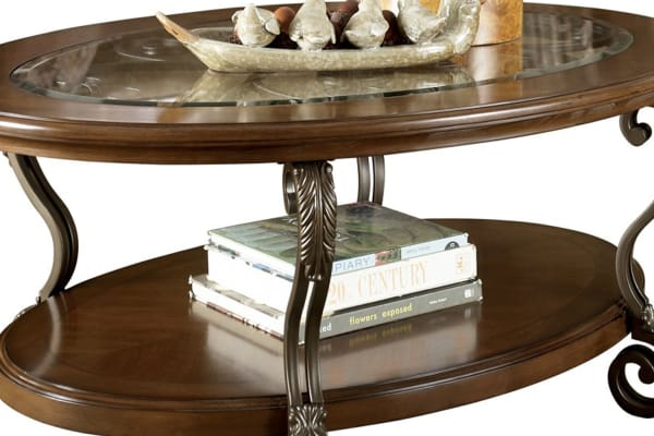 Wooden Oval Cocktail Table with Glass Top and Open Bottom Shelf, Brown