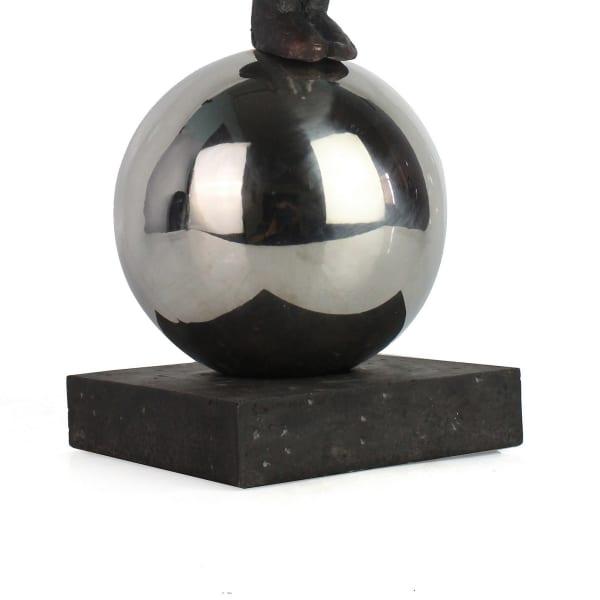 Balancing Man on Sphere Sculpture