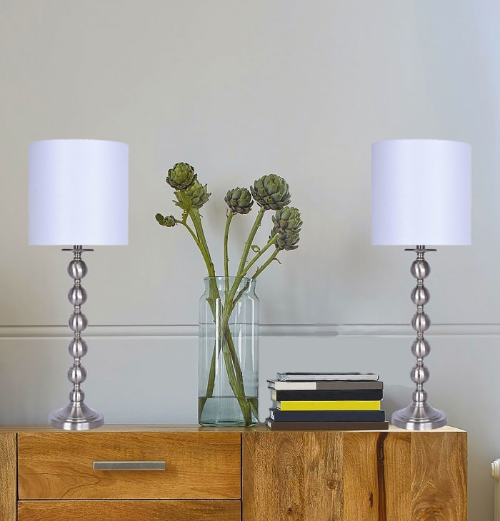 Brushed Nickel Metal Featuring Stacked Sphere Design and White Linen Drum Shades Table Lamps